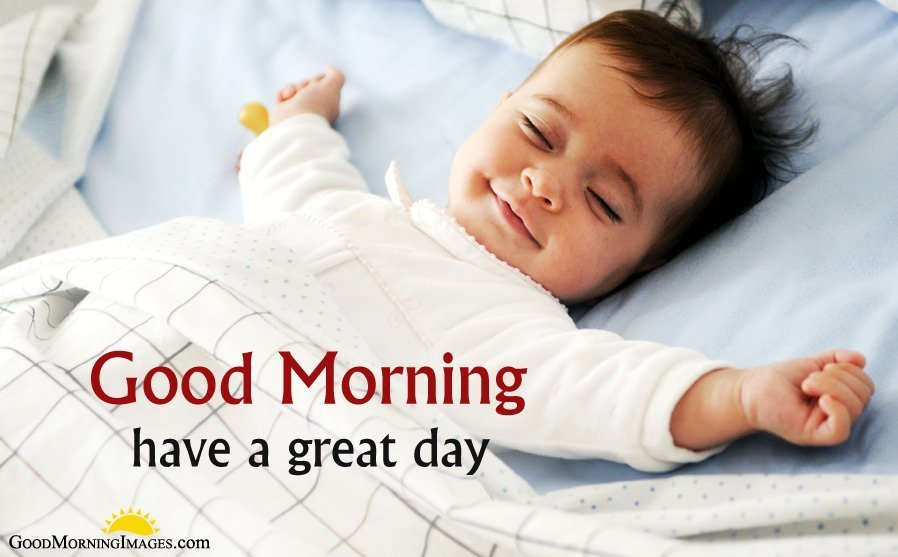 Baby in Bed with GudMrng Wishes